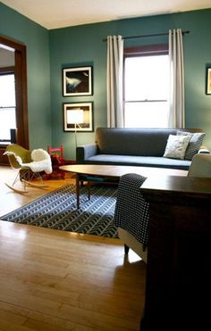I really love this wall color against the dark wood trim … plus everything else about the décor!  via Apartment Therapy