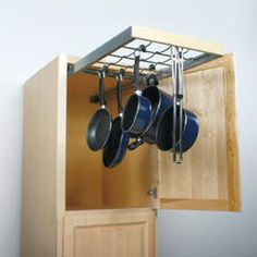 Idea for pot/pan storage!  I love this!  Finally a way to get them out of my way!