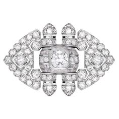 A magnificent platinum Art Deco brooch, set with   a 1,50ct center cushion cut diamond and aprox 4cts of smaller diamonds.  France, 1920