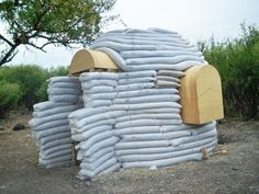 """""""Kelly Hart is your host at greenhomebuilding.com, and has built his own home using the earthbag technique, which can be seen on this page. He has adapted the concepts popularized by Nadir Khalili and his """"superadobe"""" building, by filling the bags primarily with crushed volcanic rock. This creates insulated walls that are similar to strawbale, except that they are completely impervious to damage from moisture, insects or rodents. Earthbags can be used to fashion either flat walls, curved…"""