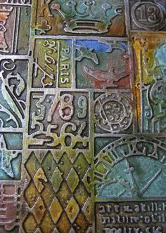 """UPDATE: foil w/gesso & alcohol inks. Did some investigating...a Tim Holtz embossing folder titled """"Patchwork"""" is used. Emboss a piece of craft metal or aluminum foil with the Tim Holtz pattern...gesso the whole thing...after the gesso dries, color with the alcohol ink(s) of your choice."""