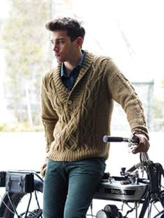 This shawl neck cabled sweater has been designed by Martin Storey using Lima.