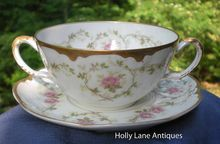 Antique Handled Soup Cup And Saucer Of Haviland Limoges -    This Haviland Pattern Features Pink Roses Along With Looping Vines On A Gently Scalloped Heavily Gold Trimmed Blank #216 -    The floral pattern encircles both the inside and the outside of this soup cup as well as the saucer.  $48.00