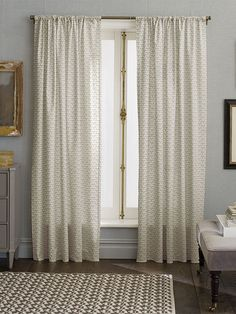 The subtle detail and neutral color in these Nate Berkus window panels add classic style to any room.