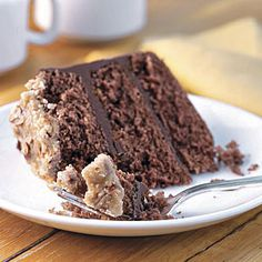 Bourbon-Chocolate Cake With Praline Frosting | Chocolate Ganache smoothed between layers of rich chocolate cake and topped with warm Bourbon Glaze make this recipe fit for special occasions.