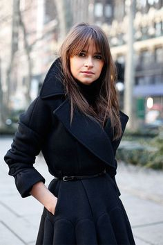 Miroslava Duma knows how to work a coat.  Love the collar and sleeve detail.  via @{this is glamorous} #thisisglamorous #miroslavaduma #hair #makeup #belt #trench #black #coat #chic