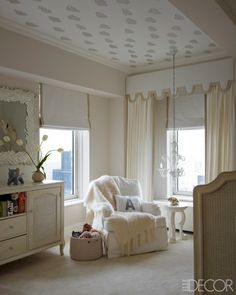 The nursery's armchair and dresser are Restoration Hardware Baby; Mohair throw by Susan Chalom thru Holly Hunt; mirror is by Marc Bankowsky; Chandelier is of Murano glass; ceiling covered in Sandberg wallpaper.