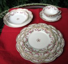 8 Piece Place Setting Of Haviland Limoges ~ Schleiger #270    Consisting of a dinner plate, luncheon plate, salad/desert plate, bread plate, soup bowl, fruit bowl, and cup and saucer.        Pattern Is Schleiger #270 On The Double Gold Trimmed Embossed And Scalloped Star Blank - Schleiger #22.    Haviland Schleiger #270 is a pattern with a wonderful rose garland design with small pink roses and green leaves that encircles these pieces and is repeated in a center design.    $250.00
