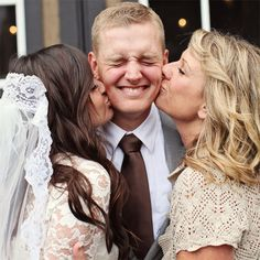 Sweet photo of the groom with his two favorite ladies — his bride and his mom!