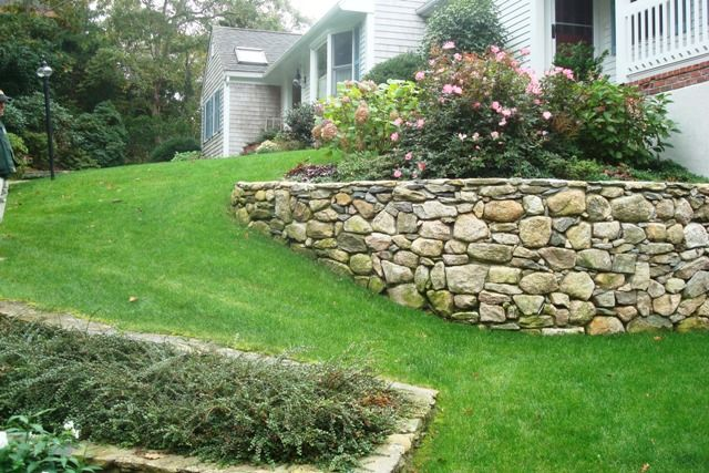 stone retaining wall sloped garden