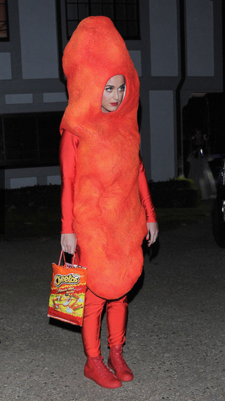 22 Celeb Costumes That Have Us Counting Down To Halloween- If Katy Perry dressed up as a flamin' hot cheetoh doesn't put you in the Halloween spirit I don't know what will. Snag some more ridiculous costume ideas from Hilary Duff, Adam Lambert, and Kim Kardashian. To see who wore it best, stalk the album on Redbookmag.com.