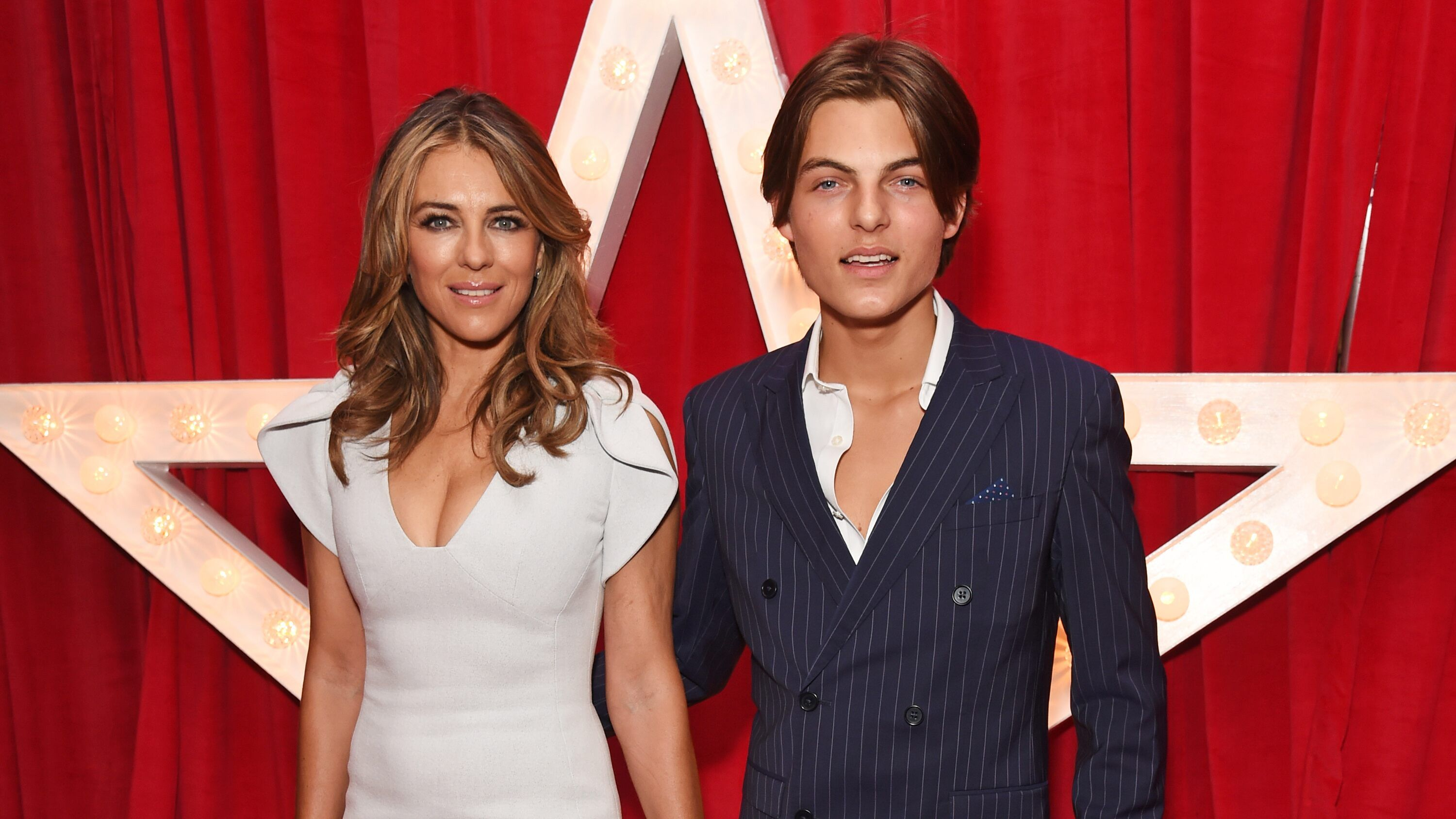 Elizabeth Hurley And Son Damian Look Like Twins As He Copies Her Sultry Pose Elizabeth Hurley Damian Hurley Hurley
