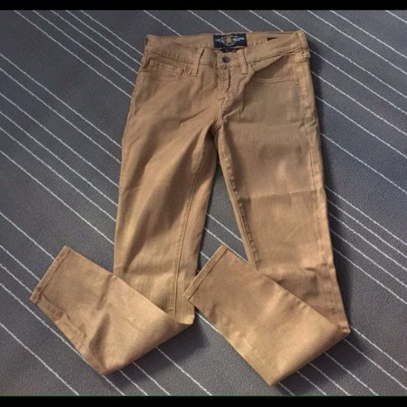 Lucky Charlie Skinny Lucky brand Charlie Skinny jeans in golden brown color. Perfect condition. Looks never used. Re-poshing because unfortunately they're too tight on me. Size 2/26 Ankle. About 27-28 inch inseam. Lucky Brand Jeans Skinny