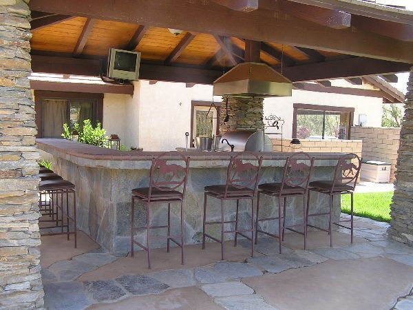 A cozy outdoor bar will add value to your property many for Outdoor kitchen bar plans