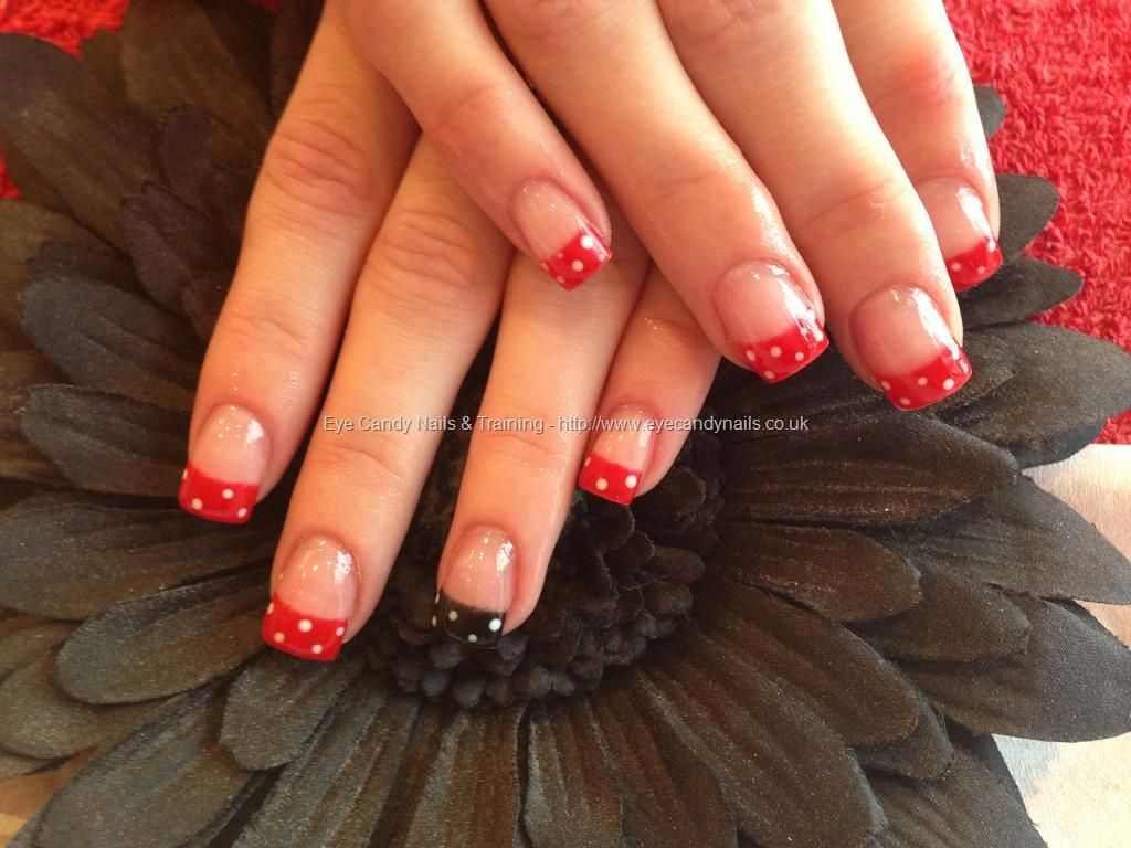 Acrylic nails with red and black polka dot nail art.....love these ...