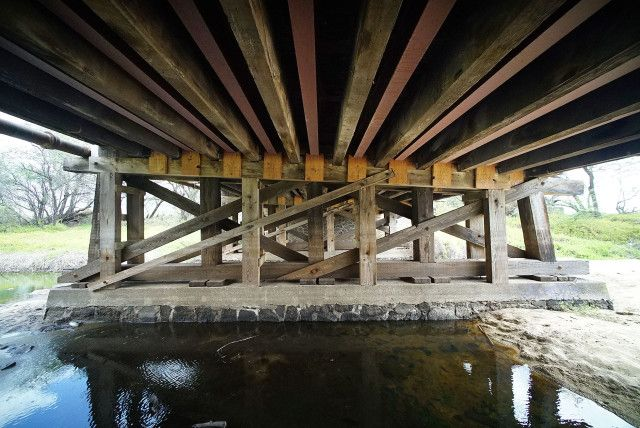 """Oldwooden planks form the surface of a 74-year-old Kalihi Street bridge far upin the Kalihi Valley. Inspections determined it to be in poor condition and gave it a rating that indicated """"local failures are possible."""" That was four years ago, but it hasn't been improved. In fact, a Civil Beat analysis of state and federal …"""