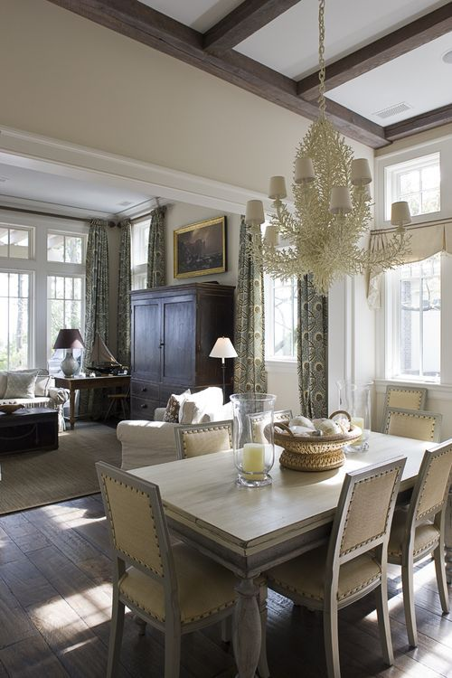 The above breakfast room and family room have curtains and valances