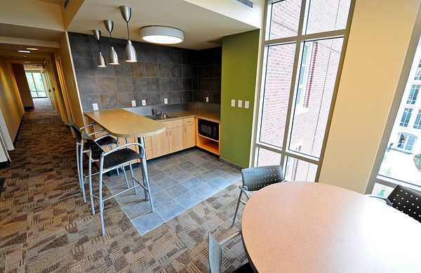 A Common Area Showing A Hallway Kitchen Area And Seating Area At First Street Towers Purdue Un Kitchen Seating Lighting Design Inspiration Diy Storage Bench