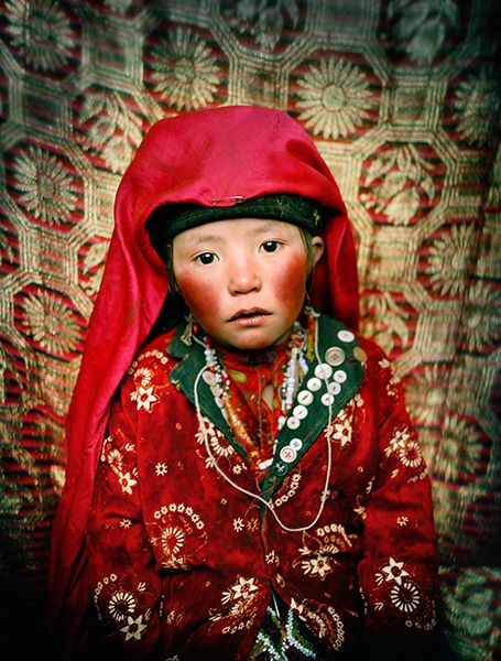 Portrait of Marbet, 7 years old. Her cheeks are red due to the cold. Image by Matthieu Paley.
