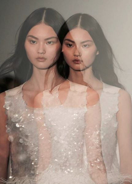 Seeing double at @jpbraganza. Ethereal beauties on the runway at LFW