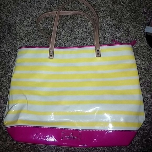 Nine west summer tote Pink yellow &white striped summer tote...has few black stains on the back Nine West Bags Totes