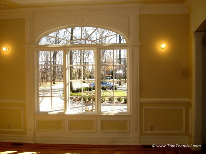 Arch Doors With Crown Molding 023 Arched Window Trimmed With Fluted Columns Panel On The Bottom Moldings And Trim Craftsman Home Interiors Fireplace Mantels