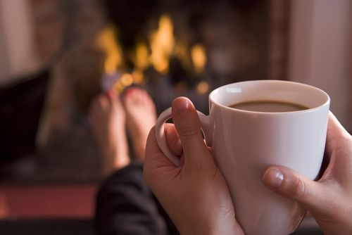 Cuddling up by the fire with some hot cocoa on a cold day