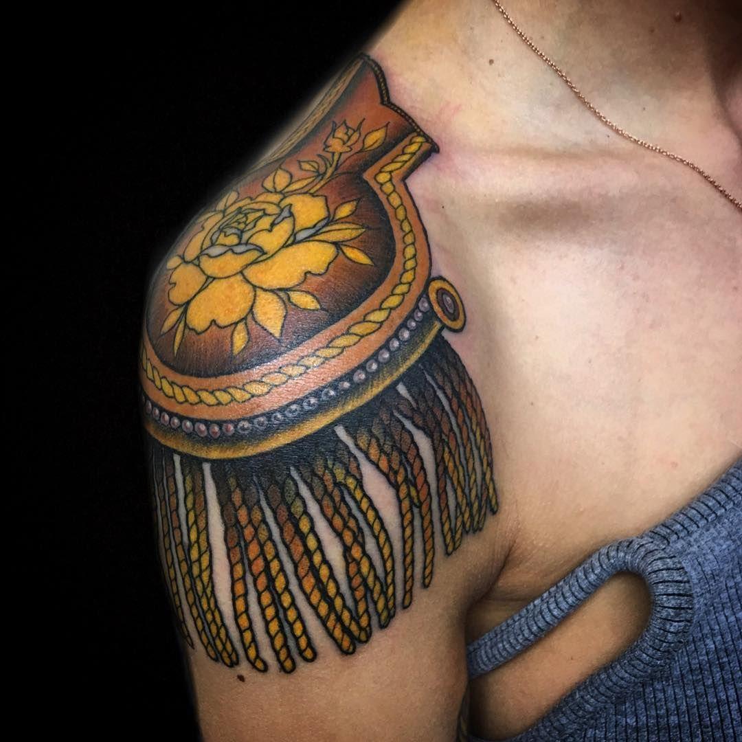 Claudia de Sabe, London... epaulette tattoo