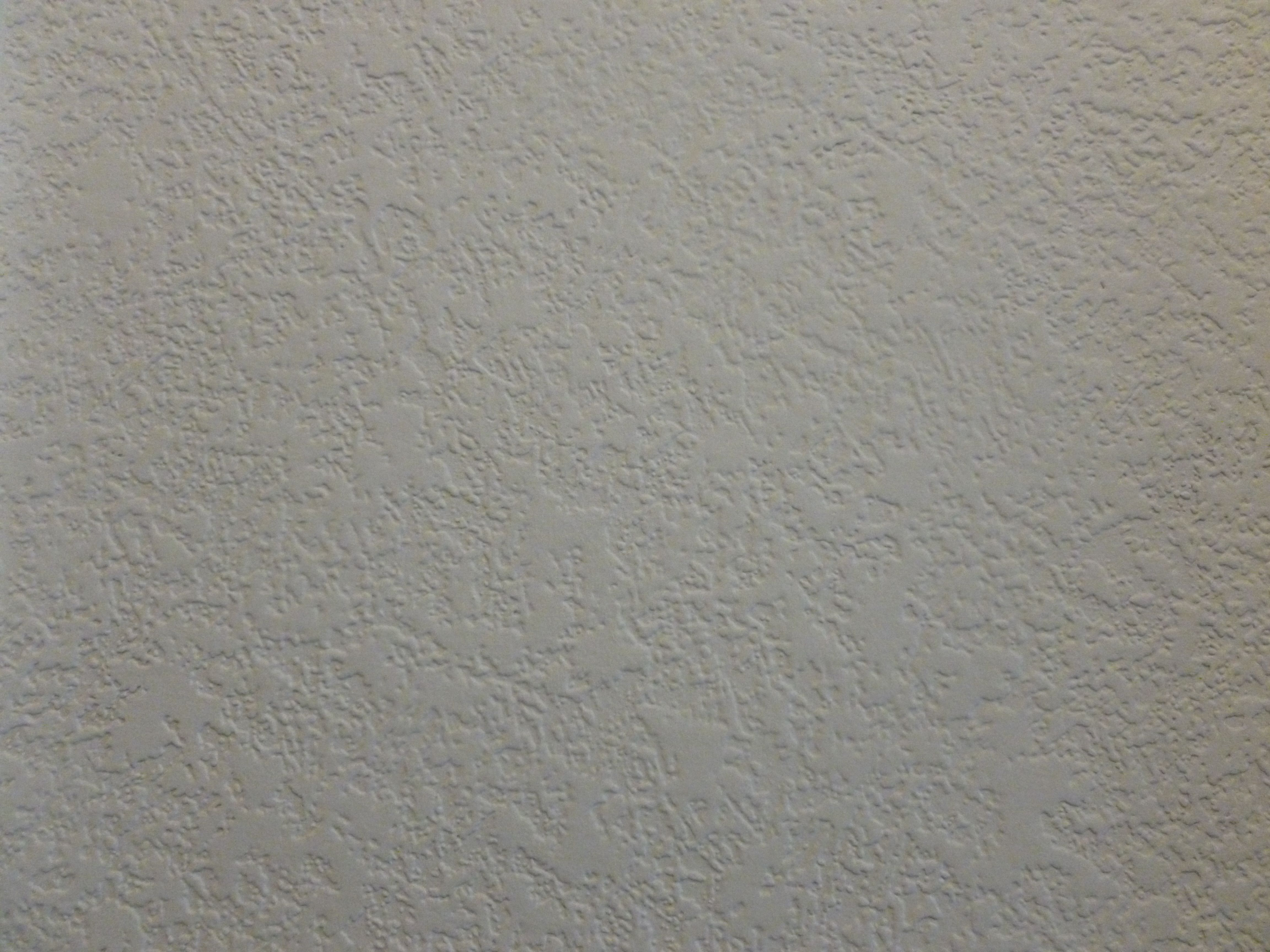 Close up of textured wall paper that you paint over to cover damaged