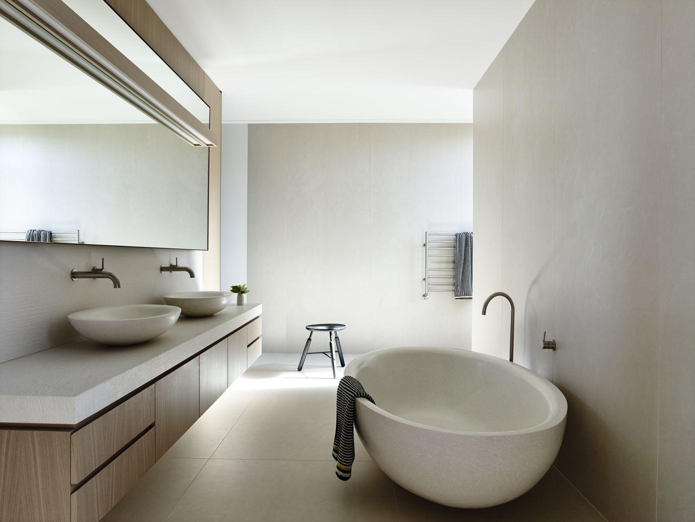 Limed oak veneer concrete bath and basins