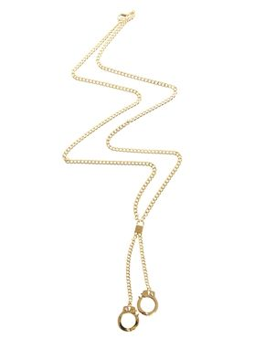 Fashion: New York City Style. Gold handcuffs pendant necklace.