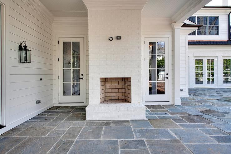 Outdoor Tile For Covered Patio   Fantastic Covered Patio Features A White  Brick Outdoor Fireplace Alongside Slate Tiled Floors.