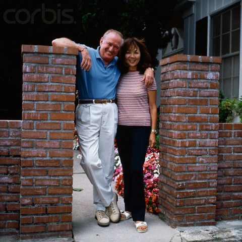 Australian actor Rod Taylor and his wife Carol Kikumura at home in Los Angeles. ~ 1997