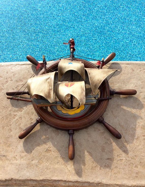 This Is A Vintage Nautical Wood Ships Wheel With Wooden Ship Model Adorned On Front