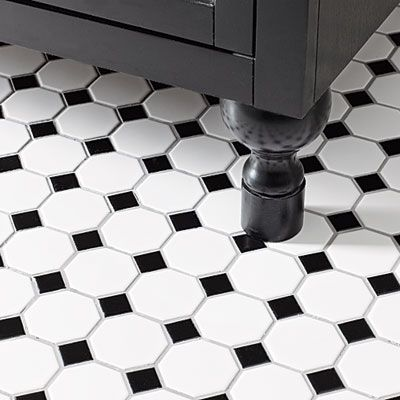 White Black Tile Floor And Cabinet Feet Extensions Made From Dowels Level The Vanity On Uneven Daltile