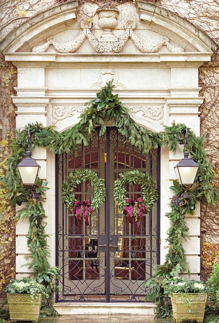 beautiful stone arch-wrought iron doors