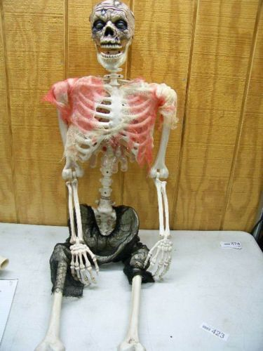 Halloween-life-size-plastic-zombie-skeleton-articulated-All-Saints - life size halloween decorations