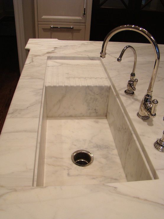 Stunning Kitchen With Honed Calacatta Gold Marble Counters Integrated Sink Paired A Polished Chrome Gooseneck Faucet