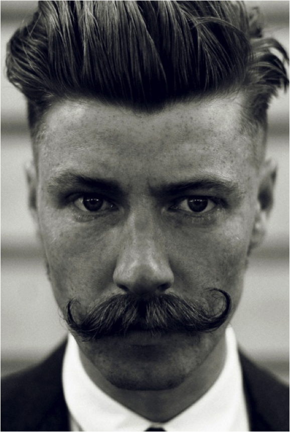 The handlebar is coming back. Would you like your man to sport one of these? Or demand it be shaved immediately?