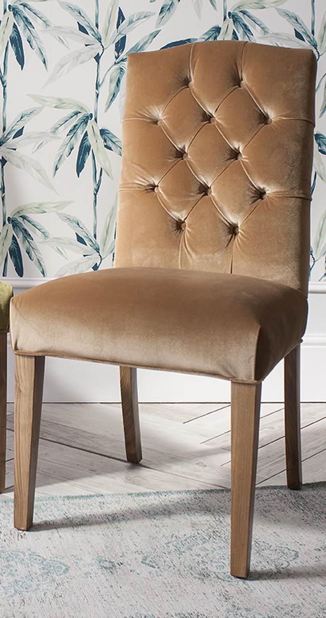 Classic velvet dining chair with timber frame, in peach colour