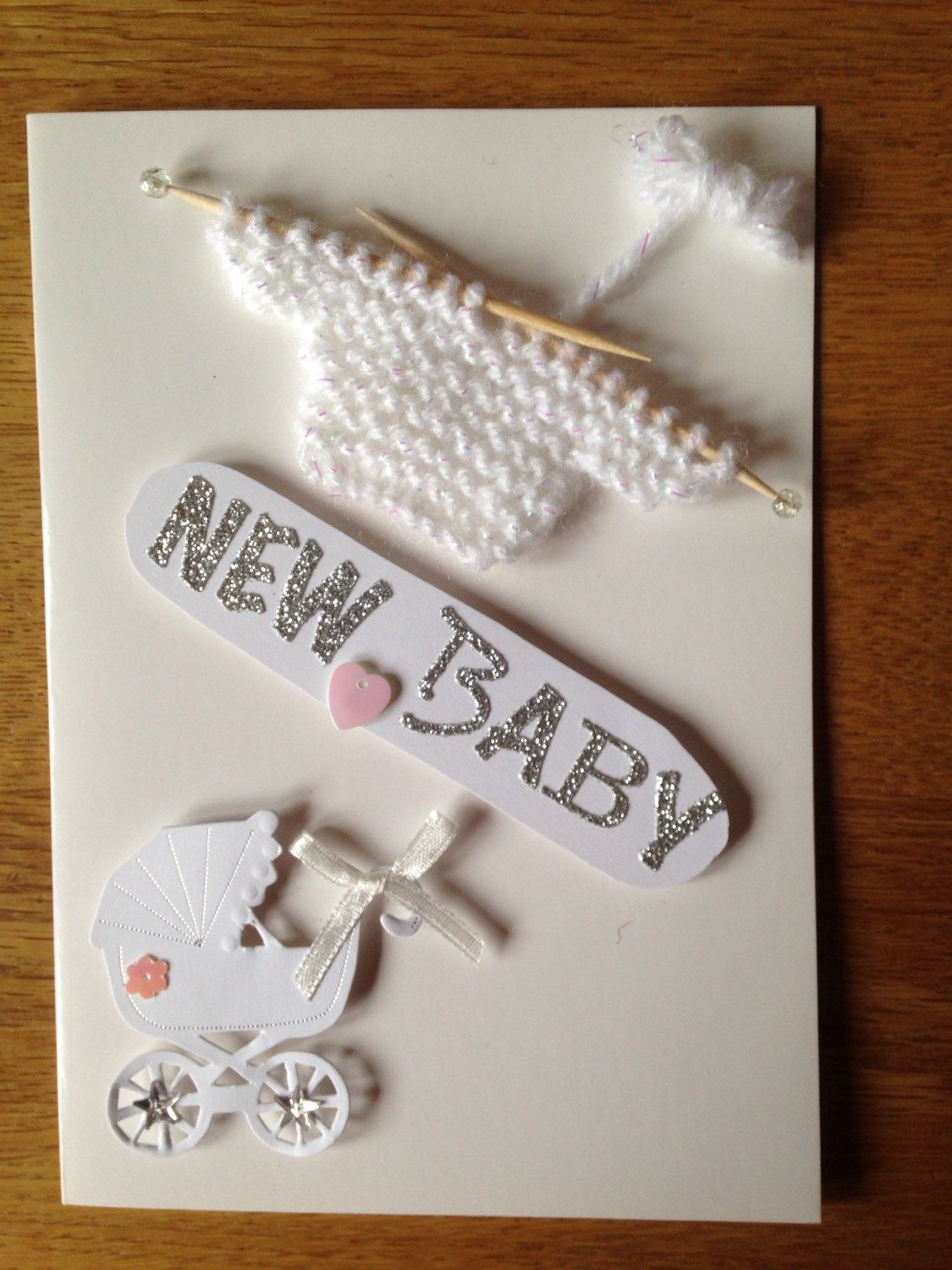 A personal favourite from my Etsy shop https://www.etsy.com/listing/231058822/white-handmade-new-baby-card-for-boy-or
