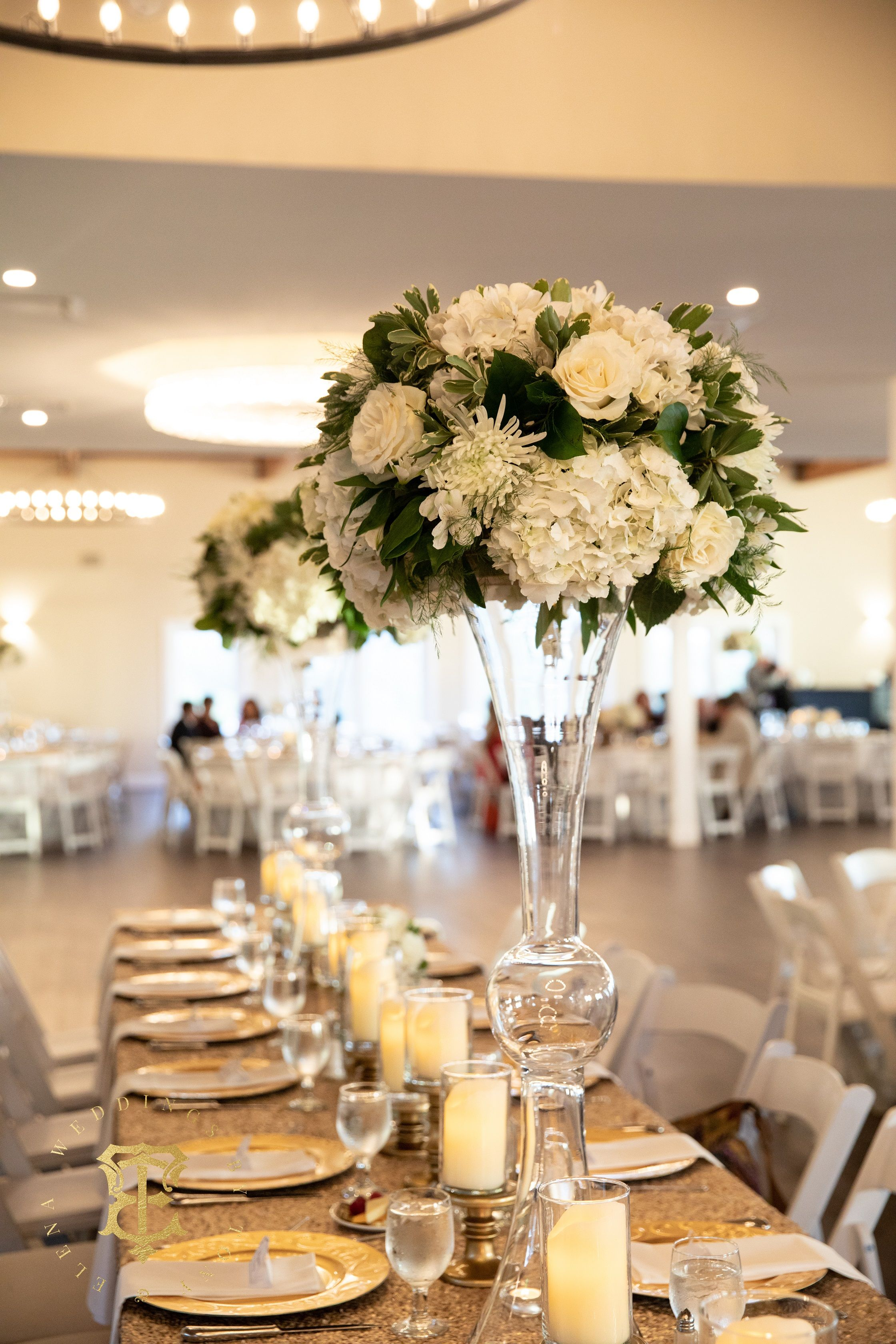 Tall Centerpiece White Flowers And Greenery Tall Centerpieces Centerpieces White Napkins