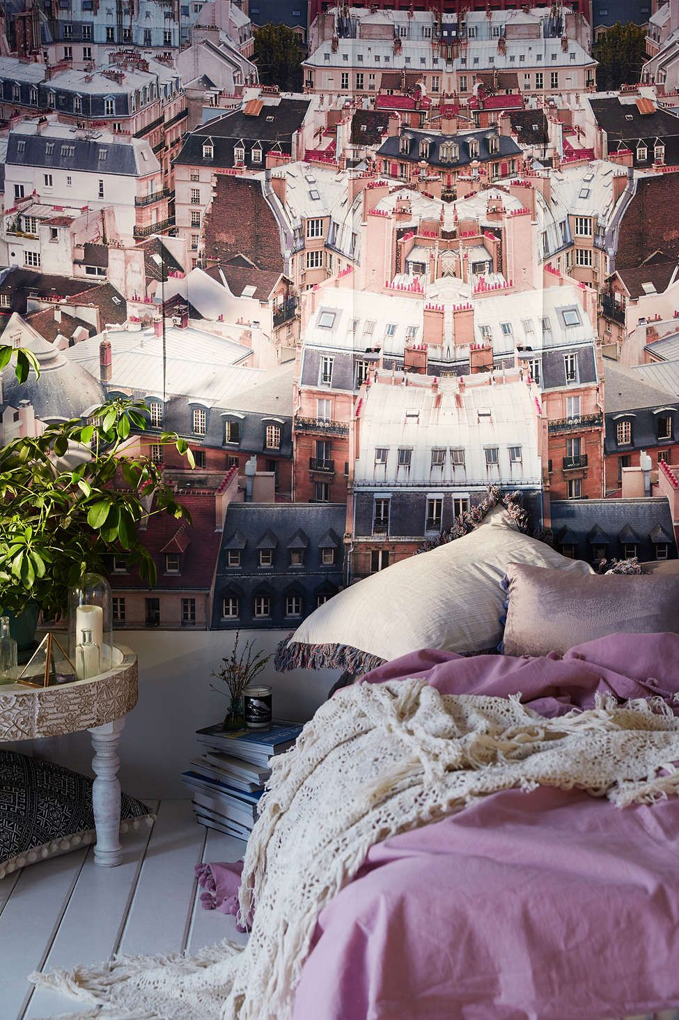 Bedroom with Parisian rooftop wall mural via Urban Outfitters