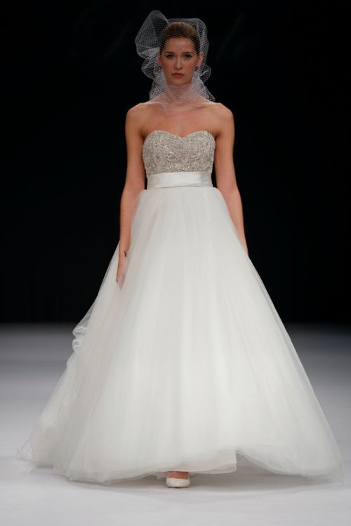 Badgley Mischka. Amazing.  Much prettier in person with GORGEOUS hand beading and crystals on the tulle skirt!