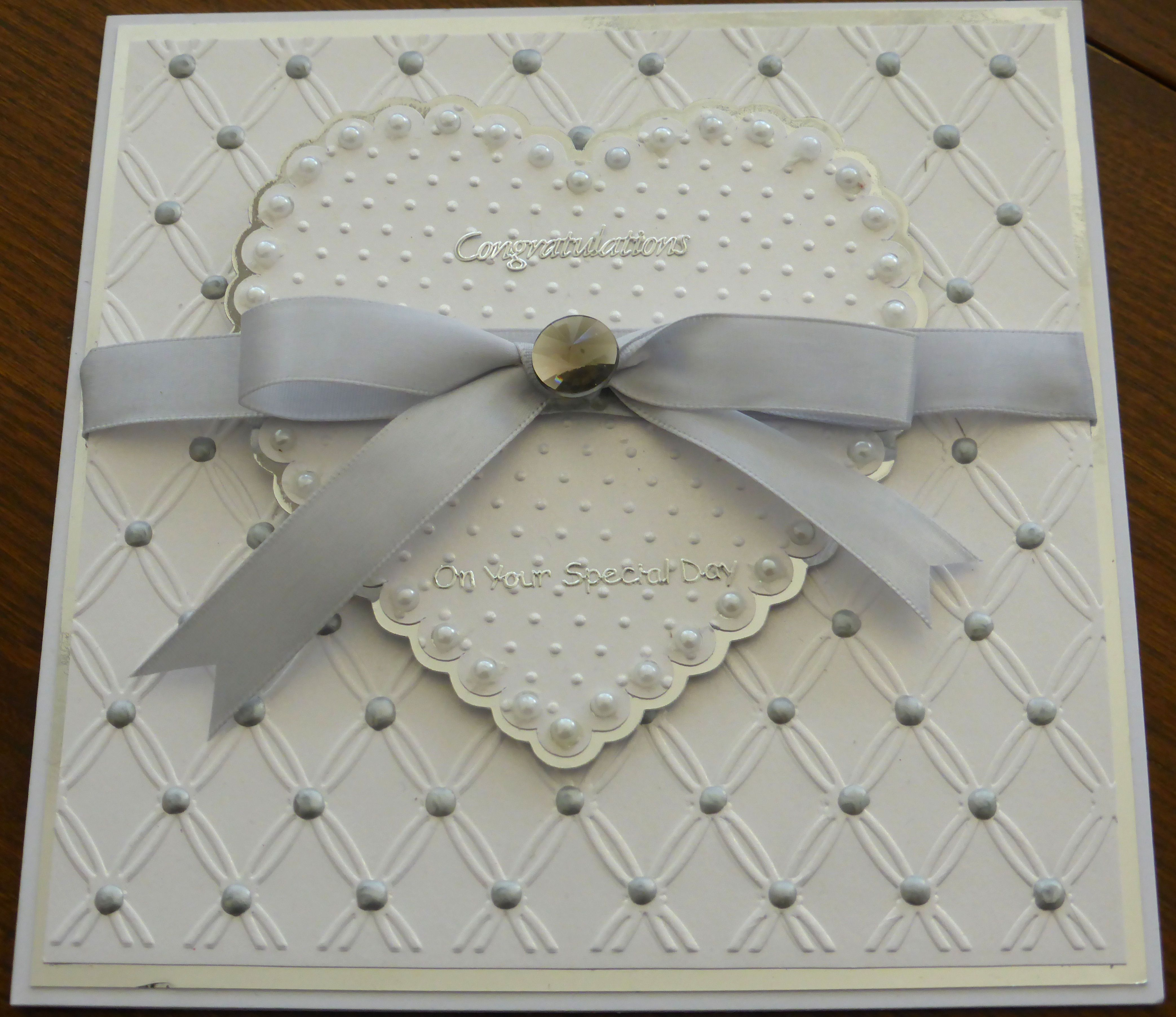 Made using Creative Expressions Embossing folder called Tied Together, Spellbinders Heart Die and Cricut Polka Dots Embossing Folder