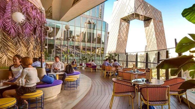 The Most Beautiful Outdoor Bars In The World Migas Mercado Beijing China Travels Dreamdestination Ou Hotel Rooftop Bar Dream Destinations Coastal Living