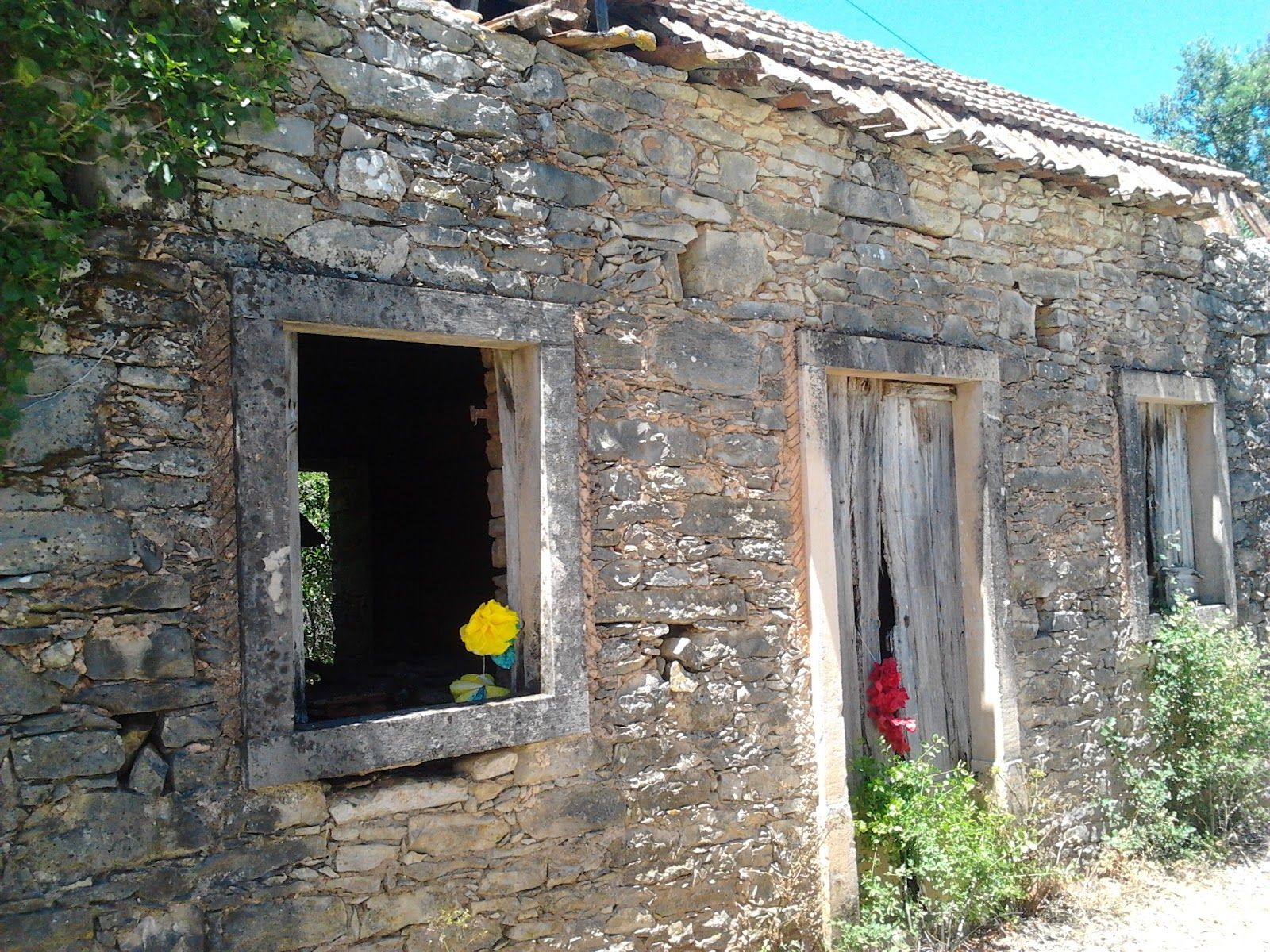 Old stone houses with a touch of color for the festa :) An American In Portugal: Summer Saints Parties in the Aldeias: The Traditions, The Food & The Fun!