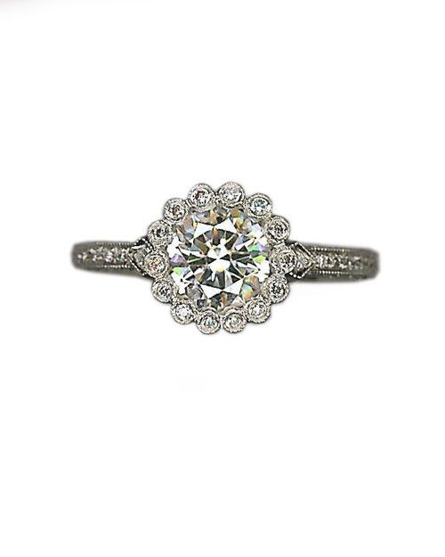 Platinum and scalloped diamond engagement ring from Cathy Waterman.