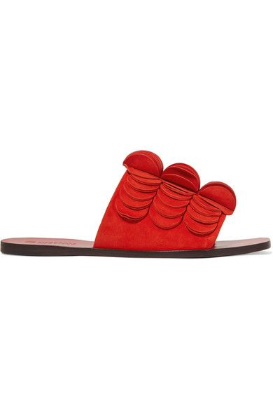 Former accessories Creative Director for Tory Burch, Mercedes Castillo launches her own eponymous collection of vivid, contemporary footwear for Spring '17. These 'Delphia' slides - a standout from the debut lineup - are crafted from soft suede in a striking red hue, with artful geometric circles appliquéd along the top. Wear yours with loose tailored pants.