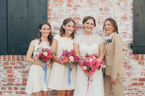 bridesmaids - photo by Lukas and Suzy VanDyke http://ruffledblog.com/colorful-carondelet-house-wedding
